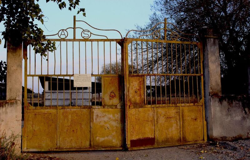 Closed gate of abandoned building