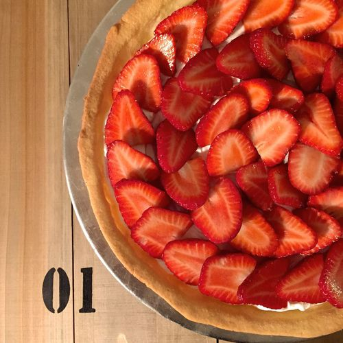 Directly above shot of strawberry tart on table
