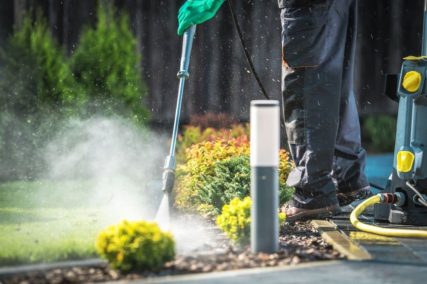 Backyard Garden Paths Cleaning with Pressure Washer. Cleaner Gardening Day Garden Holding Low Section Men Nature One Person Outdoors Pressure Washer Real People Spraying Technology Working