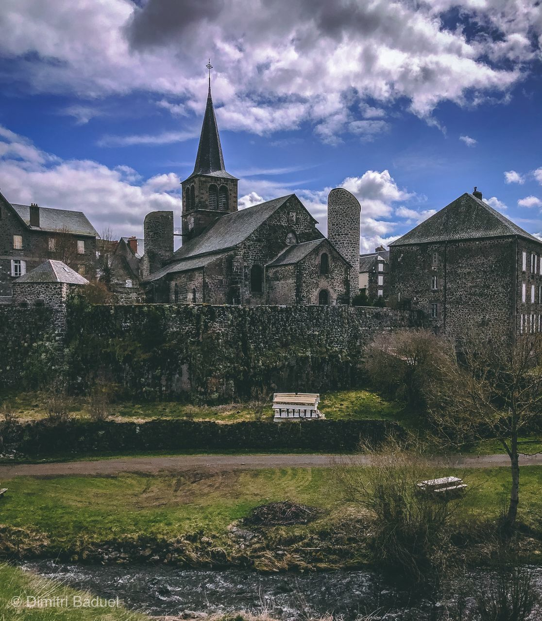 built structure, building exterior, architecture, building, religion, place of worship, sky, cloud - sky, spirituality, the past, history, belief, nature, travel destinations, grass, plant, day, no people, outdoors, abbey, spire