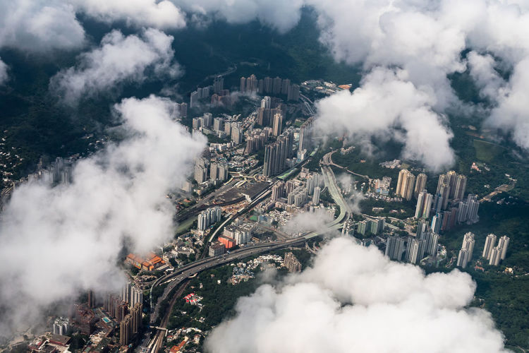 Hong Kong's top view. Aerial View Air Pollution Architecture Building Exterior Built Structure City Cityscape Cloud - Sky Day Environment Environmental Issues Fuel And Power Generation High Angle View Industry Nature No People Outdoors Pollution Sky Smoke - Physical Structure Smoke Stack