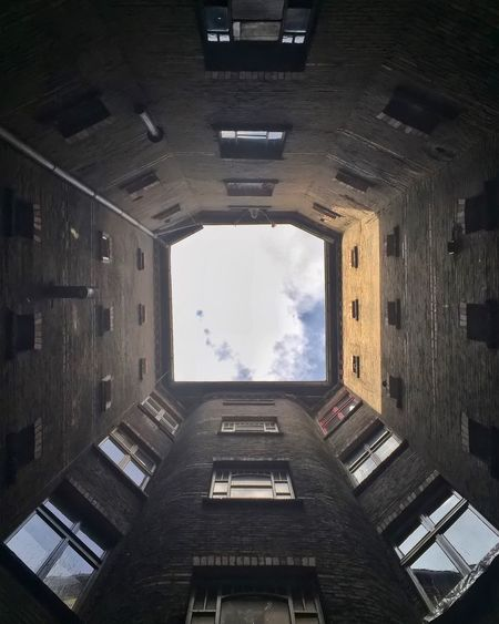 Directly Below Shot Of Skylight In Building
