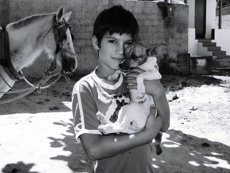 B&w Street Photography Eye4photography  EyeEm Brasil Black&white Puppy Boy And Dog Affection