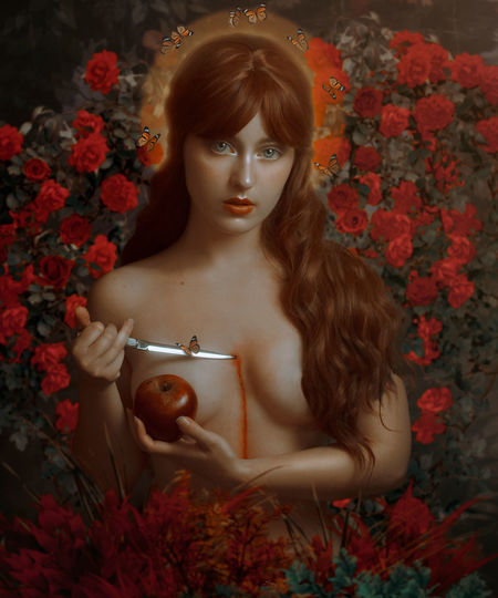 Portrait of woman with red flowers