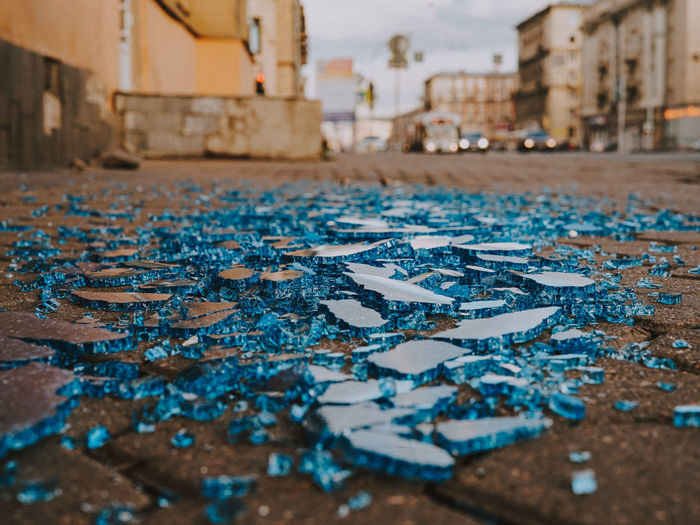 Blue glacier glass Architecture City Building Exterior Built Structure Damaged No People Water Day Focus On Foreground Street Selective Focus Close-up Outdoors Abandoned Wet Messy Run-down Misfortune Broken Flooring Deterioration Ruined Rainy Season Rain Surface Level
