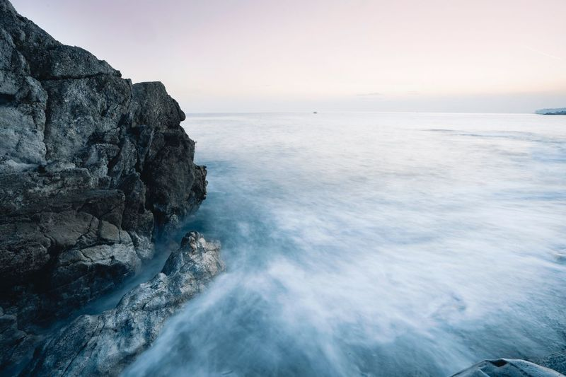 Sea Water Beauty In Nature Sky Scenics - Nature Horizon Over Water Horizon Rock - Object Idyllic Solid Nature Motion Rock Beach Tranquil Scene Tranquility Land No People Day