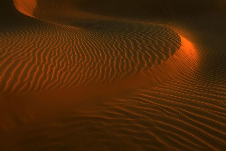 Full frame shot of sand dune at desert during sunset