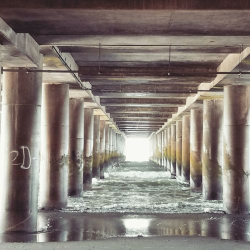 Under the pier. Ocean Pier Structure Perspectives And Dimensions Simmetry Inspiration Zen Beach Photooftheday Glow Light Onepointperspective