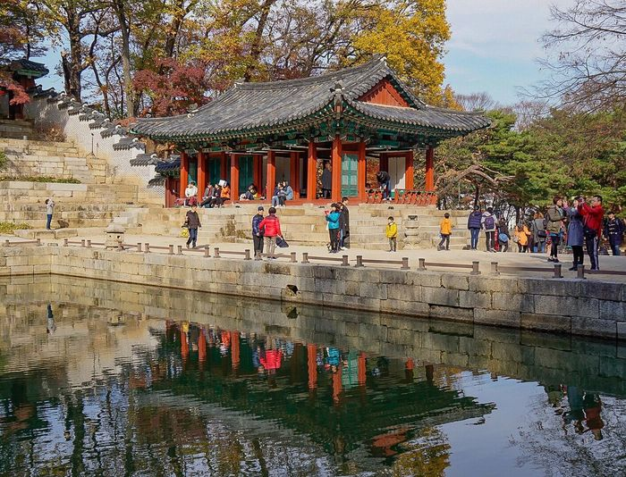 Architecture Day Water Reflection Religion Large Group Of People Tree Lake Travel Destinations Built Structure Nature Place Of Worship Outdoors Building Exterior Leisure Activity Lifestyles Real People Men Ancient Civilization Sky