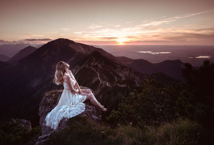 Woman in the sunset The Week on EyeEm Orange Sky White Dress Beautiful Woman Beauty Beauty In Nature Clothing Cloud - Sky Dress Herzogstand Mood Mountain Mountain Range Nature One Person Outdoors Scenics Scenics - Nature Sky Sony A6000 Sunset Women Young Adult
