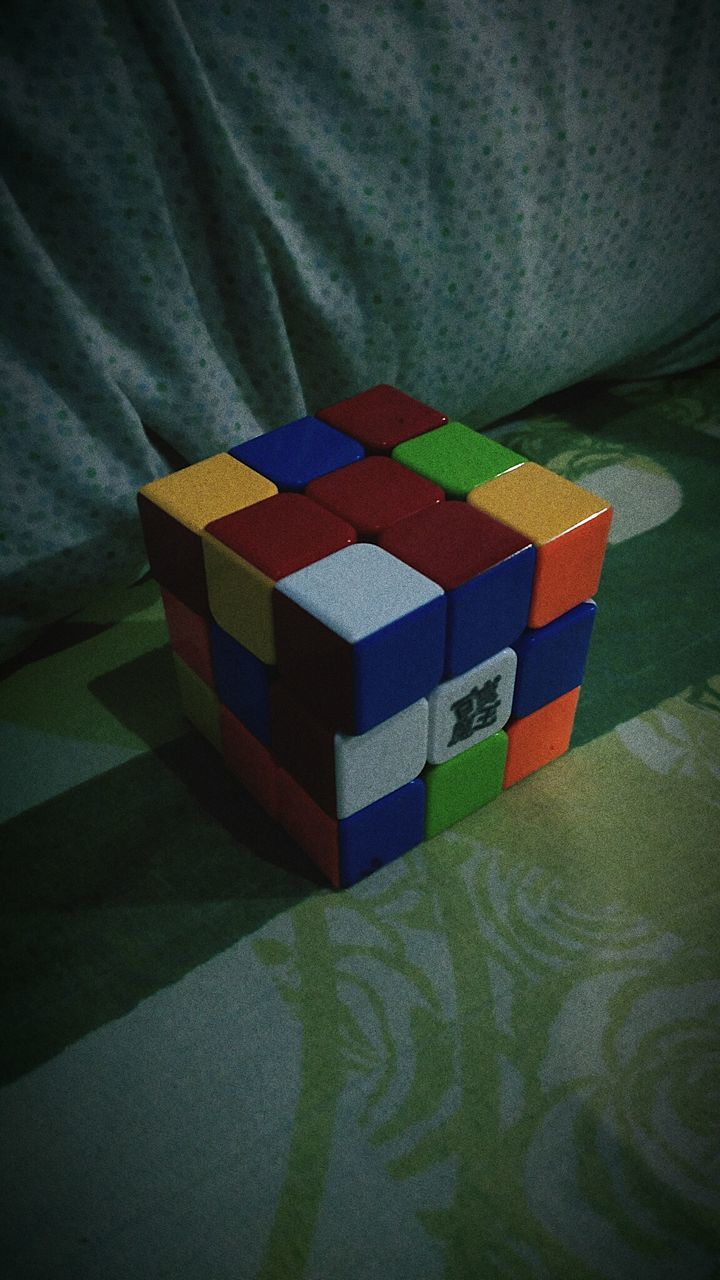 indoors, multi colored, toy block, high angle view, home interior, no people, close-up, gift, day