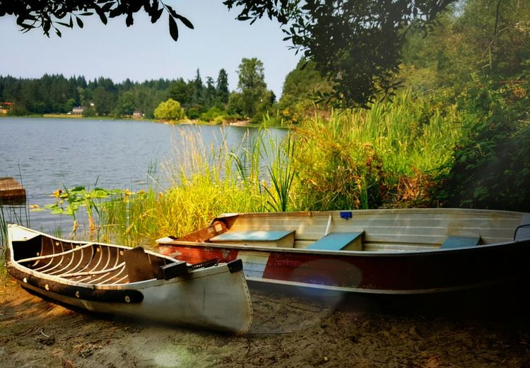 Water Lake Nautical Vessel Tree Tranquility Nature Day Outdoors No People Moored Rowboat Sky Landscape Vacations Travel Destinations Scenics Lakesideview Beauty In Nature