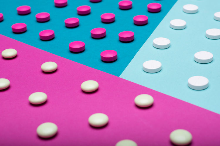 Assortment of various colourful pills on pastel coloured background. Medication and prescription pills background. Colourful Drug Industry PainKiller Pills Pink Abuse Addiction Allergy Antibiotic Background Blue Flat Lay Medication Minimal Minimalism Multicolored Pastel Pastel Colored Pharmaceutical Pill Prescription Medicine Still Life Tablets Top View