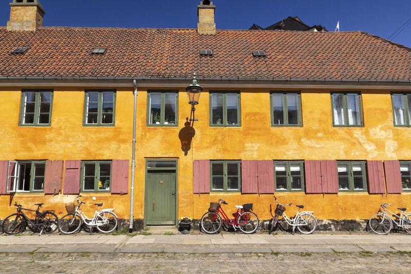 Bicycles on street against buildings