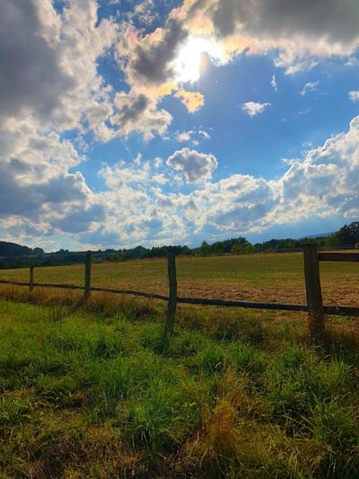 Cloudy sky Cloud - Sky Sky Fence Boundary Barrier Landscape Field Land Nature Beauty In Nature Environment No People Agriculture