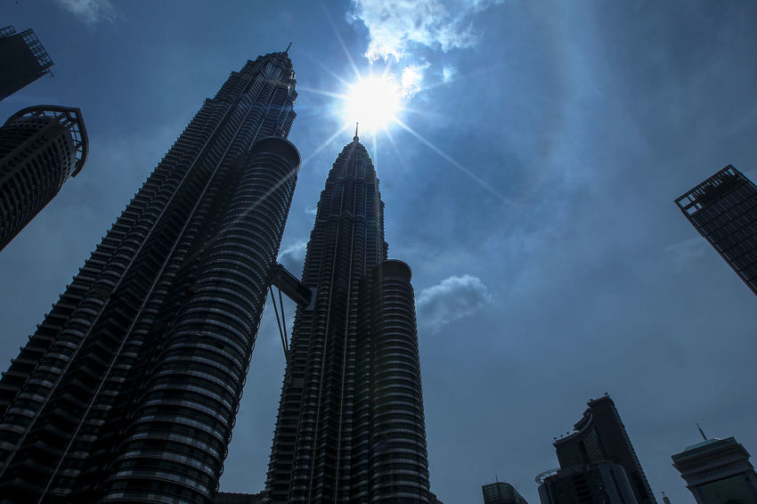Silhouette a panorama Petronas Twin Towers and another building Architecture Built Structure Building Exterior Low Angle View Sky Office Building Exterior Building Skyscraper City Tall - High Tower No People Cloud - Sky Nature Sunbeam Sun Sunlight Office Day Travel Destinations Modern Lens Flare Outdoors Financial District