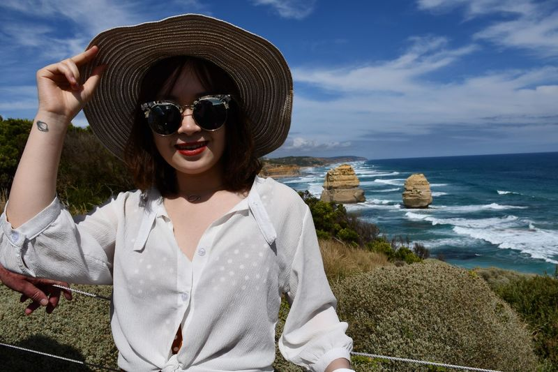 Pretty Girl EyeEm Selects Sea Water Beach Land Fashion One Person Adult Hat Horizon Over Water Front View Lifestyles Portrait Outdoors Sun Hat Nature Real People Glasses Sky Leisure Activity Sunglasses