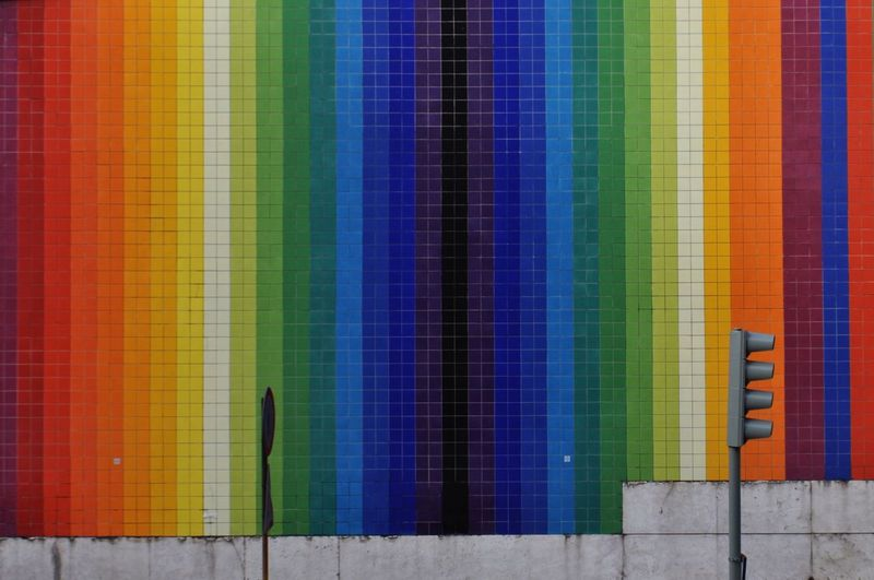Road Signal Against Colorful Wall