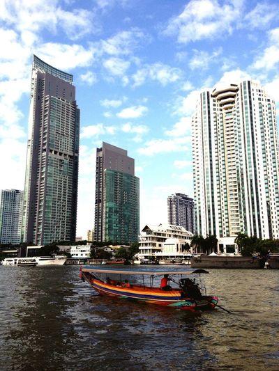 Embrace Urban Life A long-tail boat remains a main transportation in the modern city of Bangkok. Longtailboat Chaophraya River Chaophraya Khlong Transportation Boat Bangkok