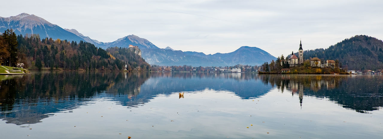 Scenic view of lake bled with mountains reflection