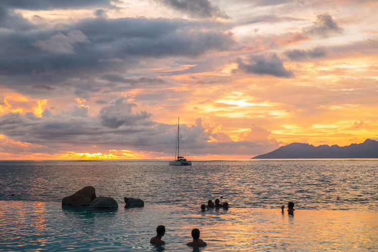 Silhouette of in infinity pool during sunset
