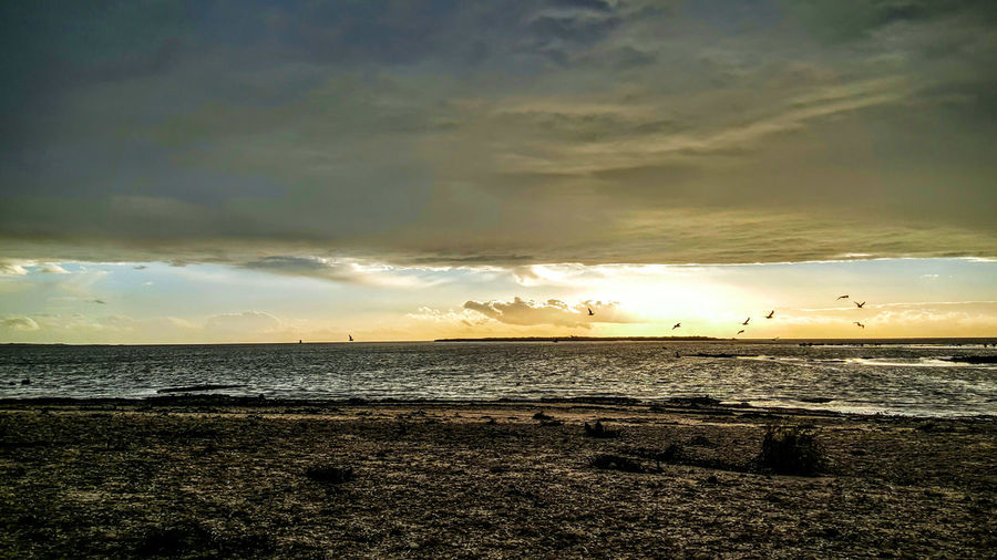 Beach Sunset Sea Water Nature Dramatic Sky Wet Beauty In Nature Outdoors Scenics Cloud - Sky No People Sky Day Outside Photography Eyeem Market Clouds Collection Travel Destinations Cloudlovers Clouds And Sky Tranquility Idyllic Tranquil Scene Sunbeam Beauty In Nature