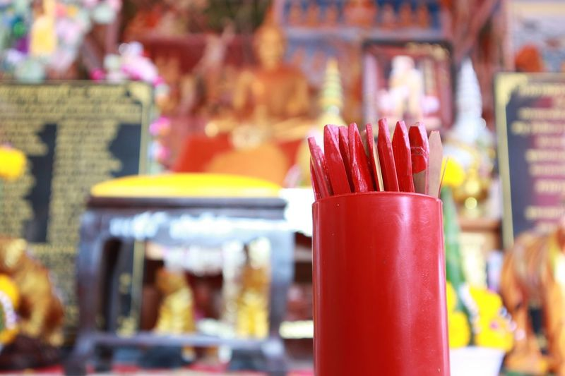 Focus On Foreground Incidental People Red Close-up Food And Drink Retail  Day Indoors  Food Freshness One Person Ready-to-eat People Temple Chi Chi Sticks Fortune Sticks Success Hopes And Dreams Hope