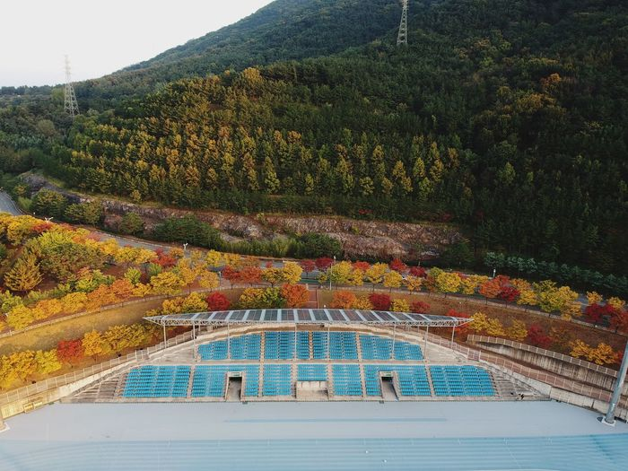 Built structure by mountain during autumn