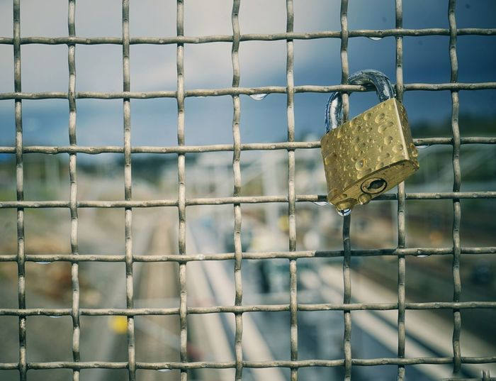 Close-up of padlock on fence