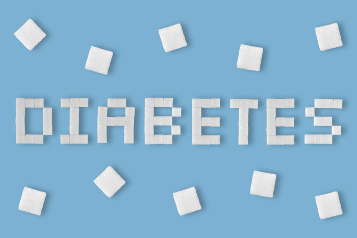 Word Diabetes written with sugar cubes Care Diabetic Diagnosis Diet Eating Obesity RISK Sugar Concept Control Creative Cubes Diabetes Disease Food Glucose Health Illness Insulin Nutrition Prevention Problem Unhealthy White Written