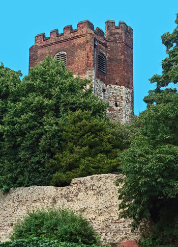 St Mary`s Church (disused) with Roman Wall in foreground Architecture Blue Building Building Exterior Built Structure Castle Church Colchester Contrast Day Exterior Green Color Hidden Gems  Hidden Places Nature Old Outdoors Roman Sky Stone Summer Sunny Town Tree Wall