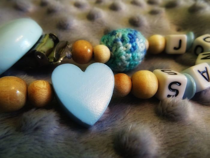 Covey Baby Accessory Heart Shape Sweet Food Indoors  Close-up No People Multi Colored Day Comforter Pacifier Dummy Childhood Name Focus On Foreground Focus Object EyeEm Ready