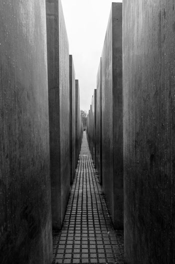 Memorial to the Murdered Jews of Europe, Berlin Architecture Blackandwhite Bnw Bnw_collection Bnw_friday_eyeemchallenge Built Structure History Holocaust Memorial Leading Lines Memorial Memorial To The Murdered Jews Of Europe No People Outdoors Perspective The Way Forward