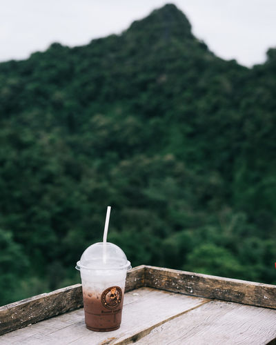 a Coffee in the hill Coffee Coffee - Drink Cup Day Drink Food And Drink Freshness Glass Nature No People Outdoors Still Life Table Tree Wood - Material