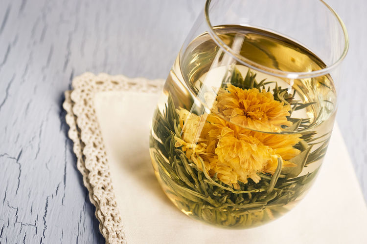 High angle view of flower in glass on table
