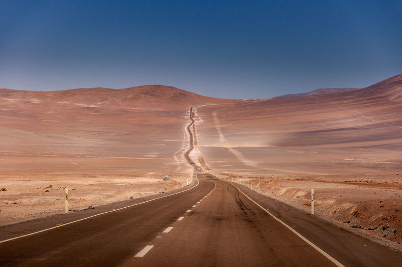 Road to the desert Atacama Desert Desert Arid Climate Beauty In Nature Clear Sky Day Desert Dividing Line Highway Landscape Mountain Mountain Range Nature No People Nowhere Outdoors Road Scenics Sky The Way Forward Tranquil Scene Tranquility Transportation Winding Road
