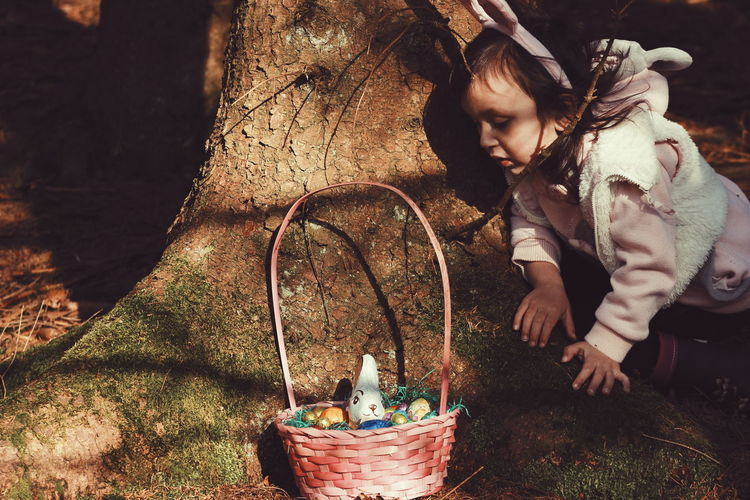 Easter is the only time of the year when it's perfectly safe to put all your eggs in one basket. Outdoors Natural Light Exceptional Photographs EyeEm Best Shots - People + Portrait Rabbit Bunny  Storytelling Easter Ready A Beautiful Day Portrait Of A Girl Portrait Portraiture Girl Childhood Springtime Easter Eggs Light And Shadow Woods Into The Woods Connected With Nature Fine Art Photography People And Places