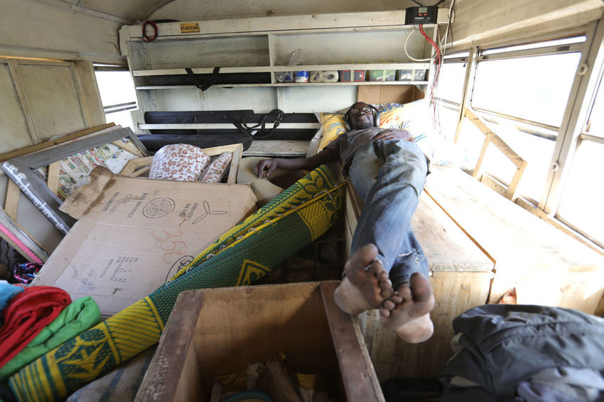 Stopping over land in Africa Bus Repair Cramped Bus Creative Bus Dakar Dakar Sign East Senegal Mali Molue Bus Nature Travel WestAfrica With The Bus Through Africa Workshop Adventure African Nature Baobab Bus Stop Bus Travel Cows Passing Bus Digital Pit Stop Senegal Tea Time