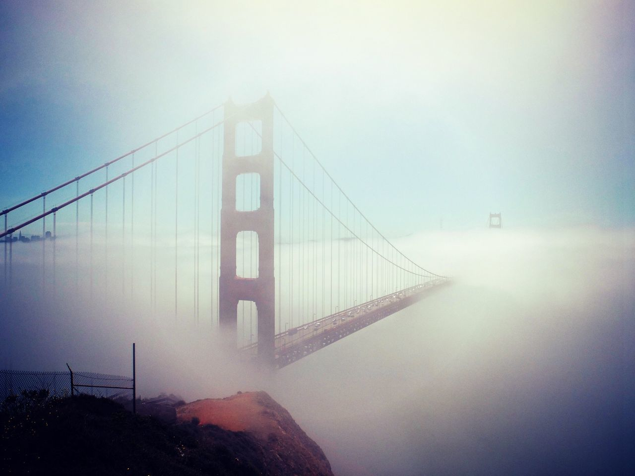 bridge - man made structure, suspension bridge, connection, fog, engineering, foggy, transportation, architecture, outdoors, travel destinations, sky, bridge, river, built structure, travel, no people, day, mountain, water, nature, city