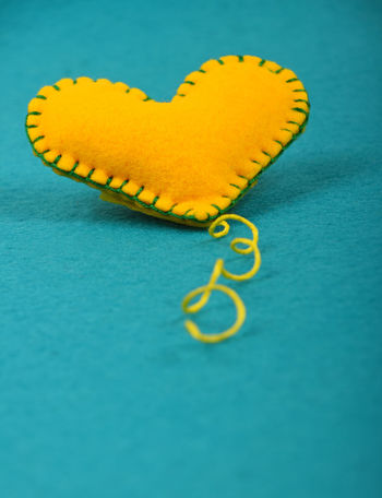 Felt craft yellow stitched heart over teal Art Blue Close-up Color Palette Colorful Colors Colour Of Life Creative Creativity Design Feelings Felt Felt Craft FeltCraft Gift Handicraft Handmade Heart Love Romance Romantic Valentine Valentine's Day  Yellow