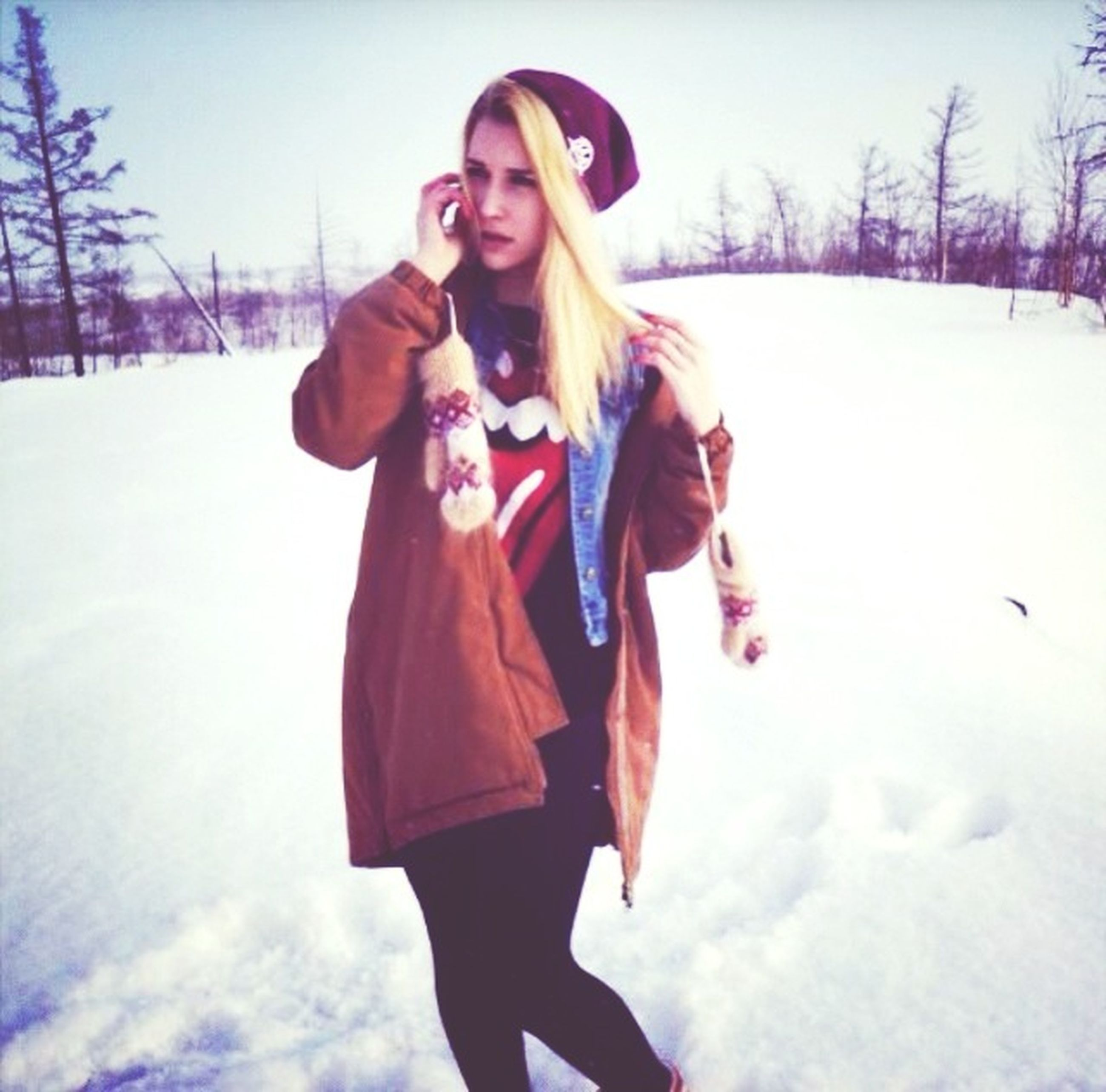 winter, snow, cold temperature, lifestyles, season, leisure activity, person, warm clothing, looking at camera, young adult, weather, full length, standing, casual clothing, front view, portrait, young women, three quarter length