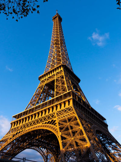 Eiffel tower in paris from a low perspective Architecture Built Structure Tower Sky Low Angle View Travel Destinations Metal Tourism History The Past Travel Architectural Feature Iron - Metal No People Tall - High Historical Building Eiffel Tower France Europe Cultural Landmark Historic Golden Hour Cultural