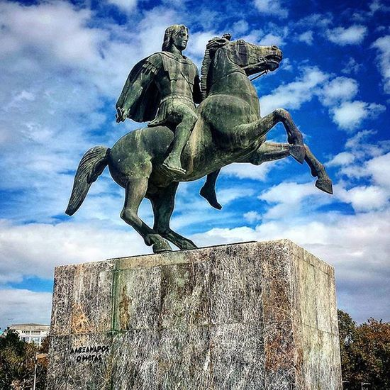 Alexander the great Leader Great Greek Macedon Dynasty Voukefalas Army Clever History Routes Oner Pride Batle India Percia Alexandria Greekcivilization Beautiful Powerful Statue City center Monument Sky Clouds Sun colours white blue marble iron