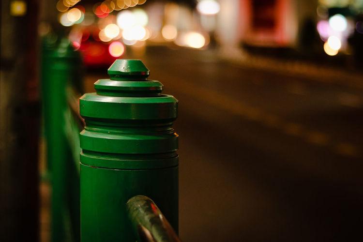Close-up of illuminated lighting equipment on street