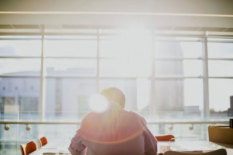 Resume.. Resumes Office Sunrays Togetherness Men Sitting Rear View Soft Focus Enjoyment Lens Flare Copy Space Conference Table Brainstorming Business Casual Office Chair Creative Occupation Business Meeting