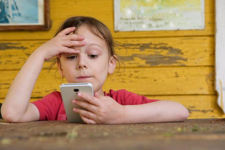 Girl Using Phone At Table