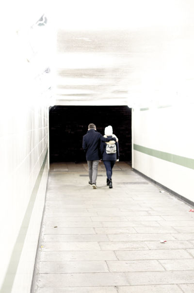Walking Out Into The Night Walking Night Time Into The Night Friendship Two Friends Photo Edit Over Exposure High Contrast Dramatic Underground Tunnel Children Of The Night Photoshoot Backstreets Street Photography Pentax K5 50mm