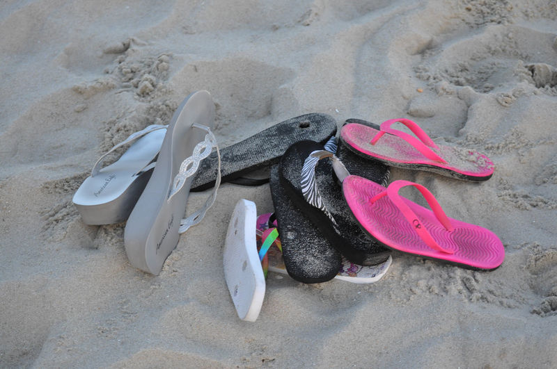 Pile of Flip Flops on a Sandy Beach New Jersey Absence Beach Flip-flop Nature No People Outdoors Pair Sand Shoe Shore Things That Go Together Vacations