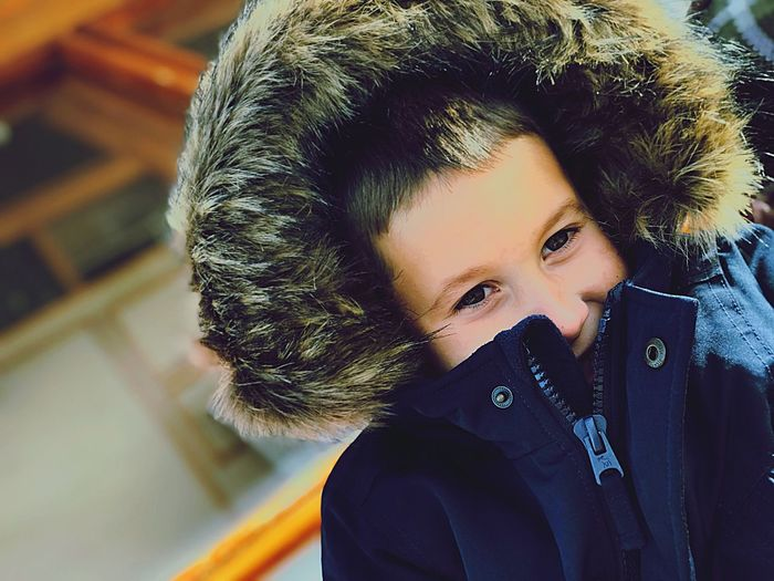 Close-up of boy wearing warm clothes