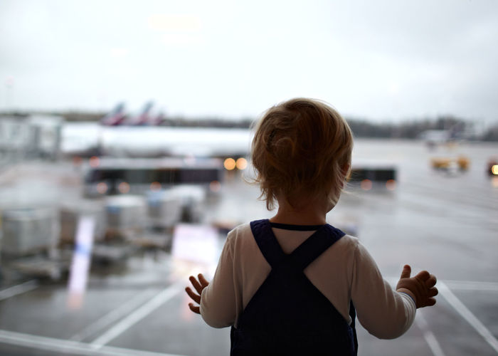 Aircraft Airplane Airport Baby Boy Caucasian Destination Flight Glass Hall Kid Plane Silhouette Terminal Toddler  Tourism Transportation Travel Vacation Watching Window